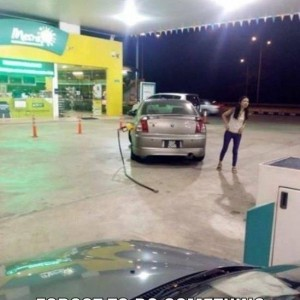 Girl-driving-at-Gas-Station-300x300